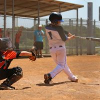 youth boy up to bat for baseball