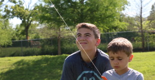 brothers flying a kite