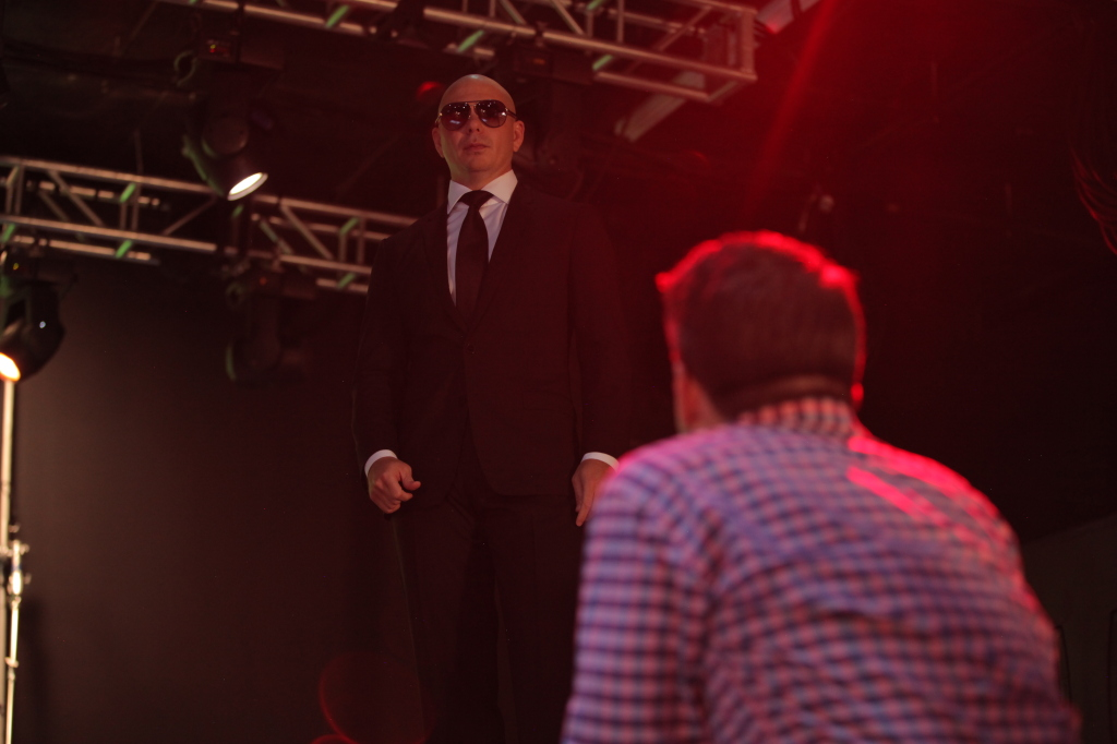 "Pitbull on the set of the music video for ""Celebrate (from Penguins of Madagascar)."""