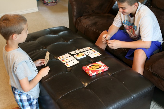 Boys Playing Karma Card Game
