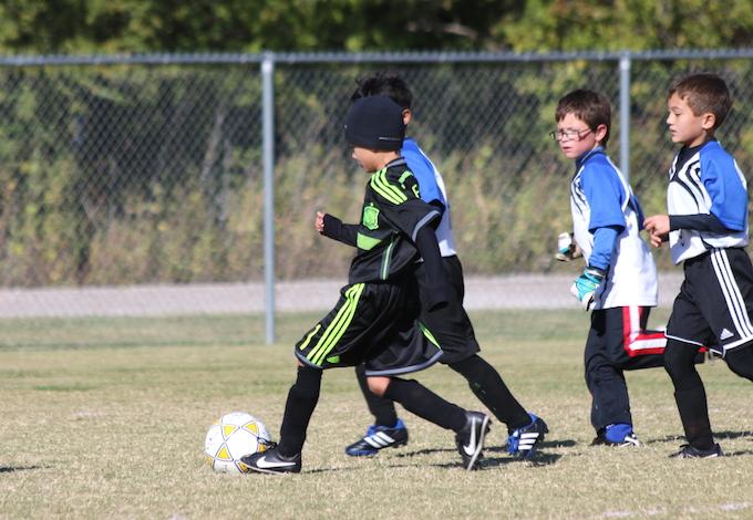 Noah playing soccer