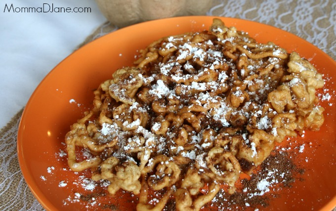 pumpkin spice funnel cake with powder sugar