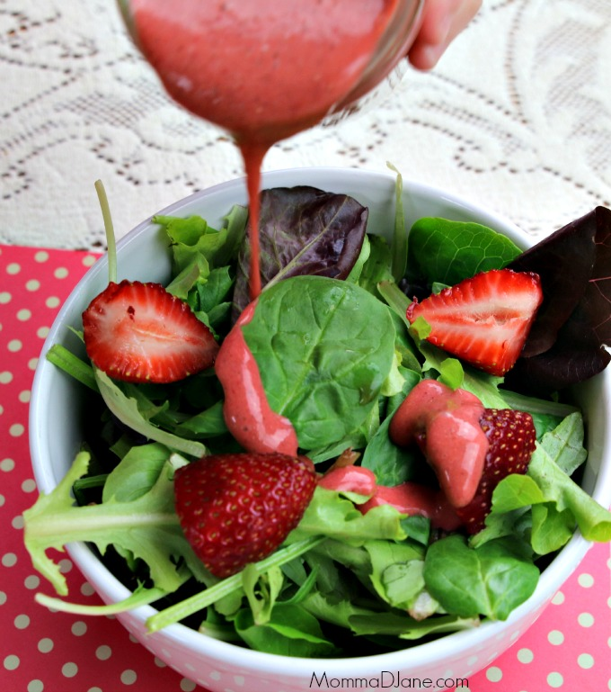 pour strawberry dressing on salad