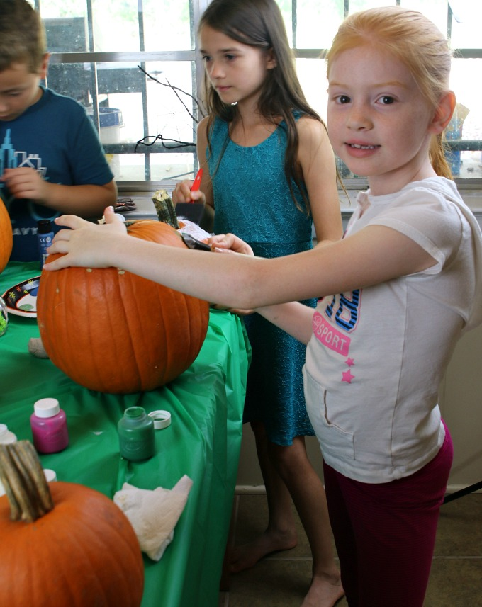 emma-painting-pumpkin