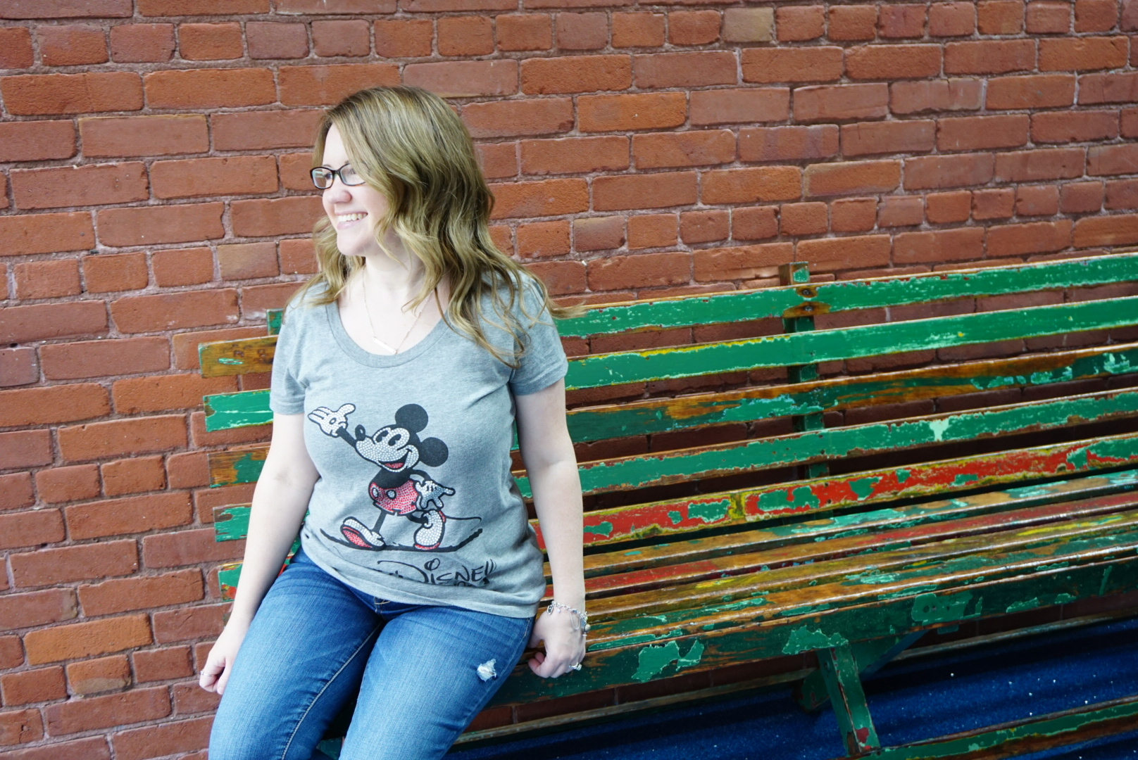sitting on Walt Disney's bench from Griffith Park in museum
