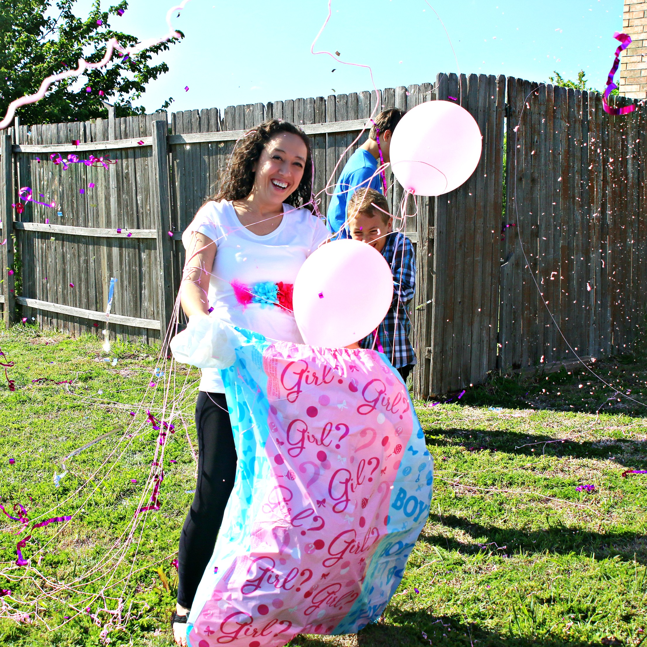 gender reveal surprise with balloons
