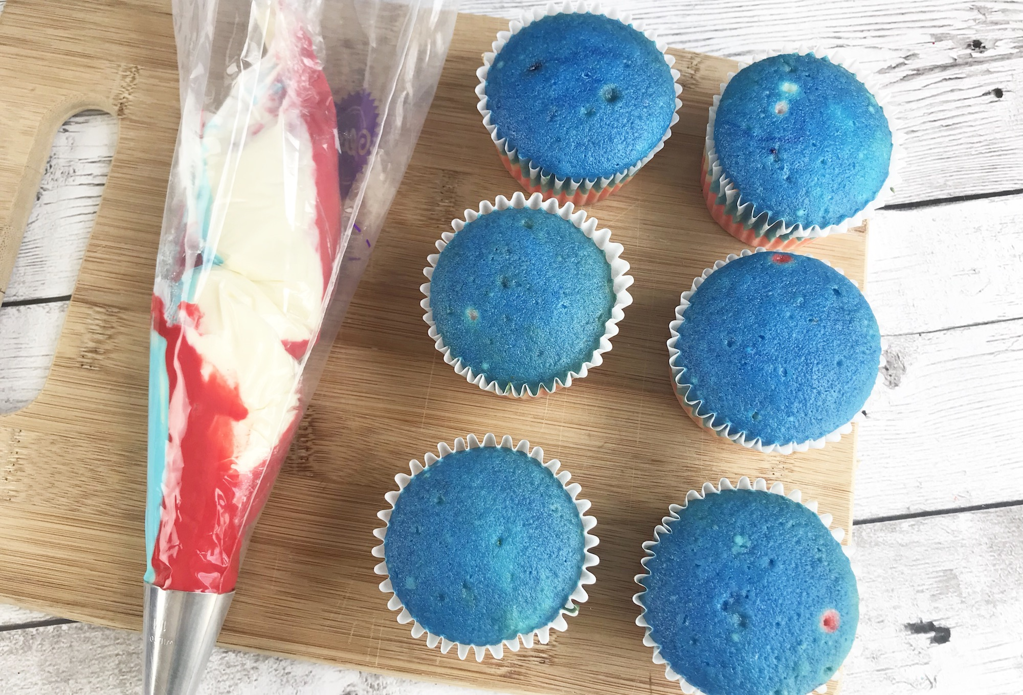 how to use a piping bag to decorate superhero cupcakes