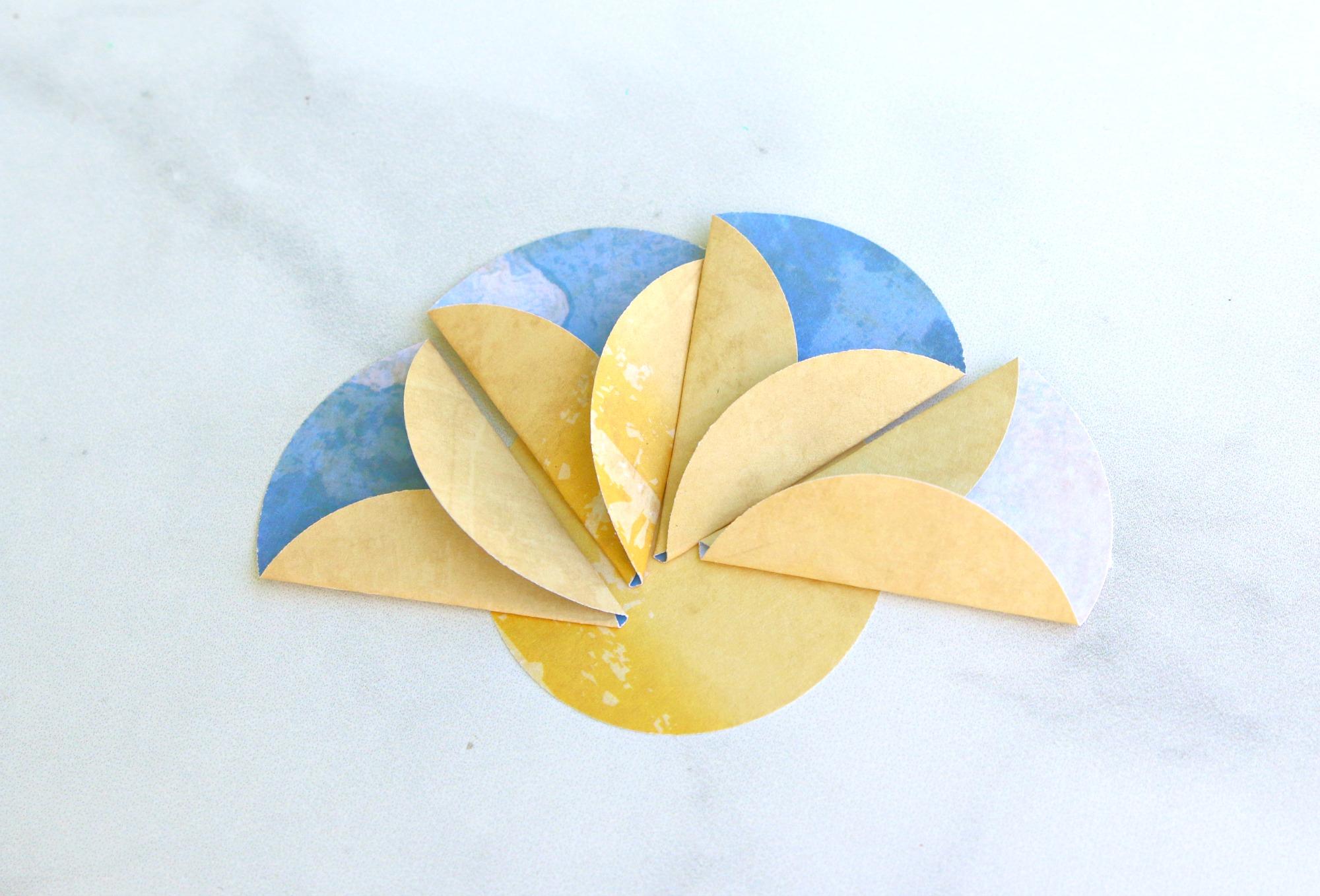 add scrapbook paper petals to flower center