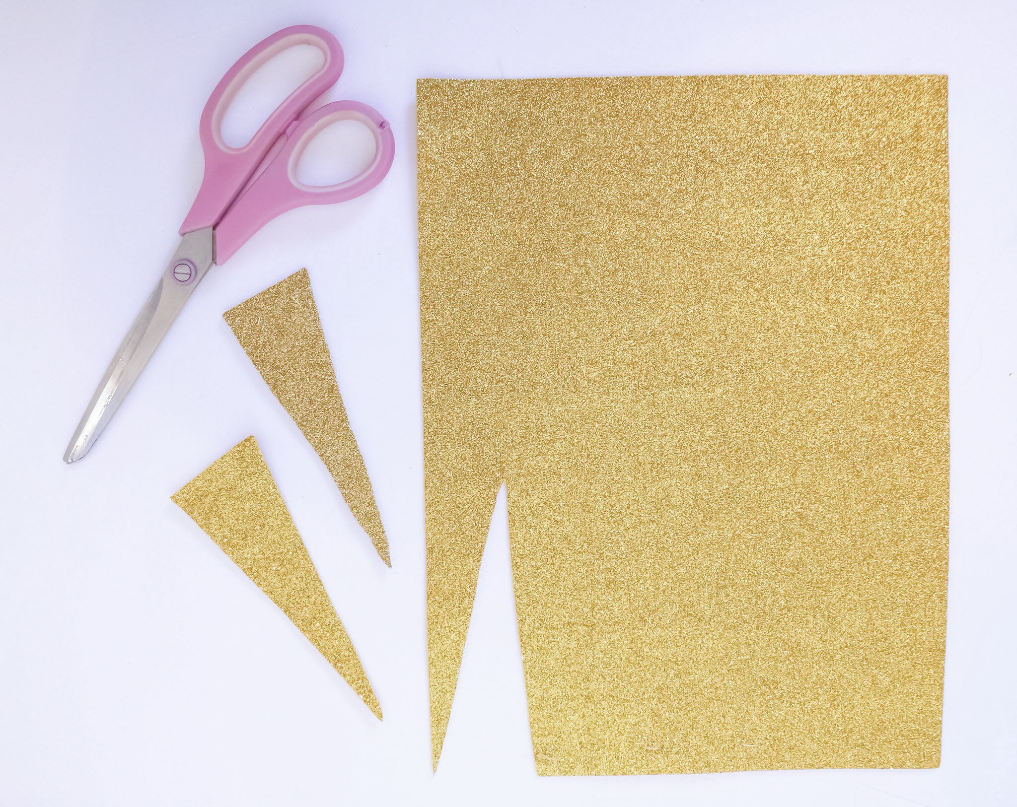 Cut glitter scrapbook paper for unicorn horn