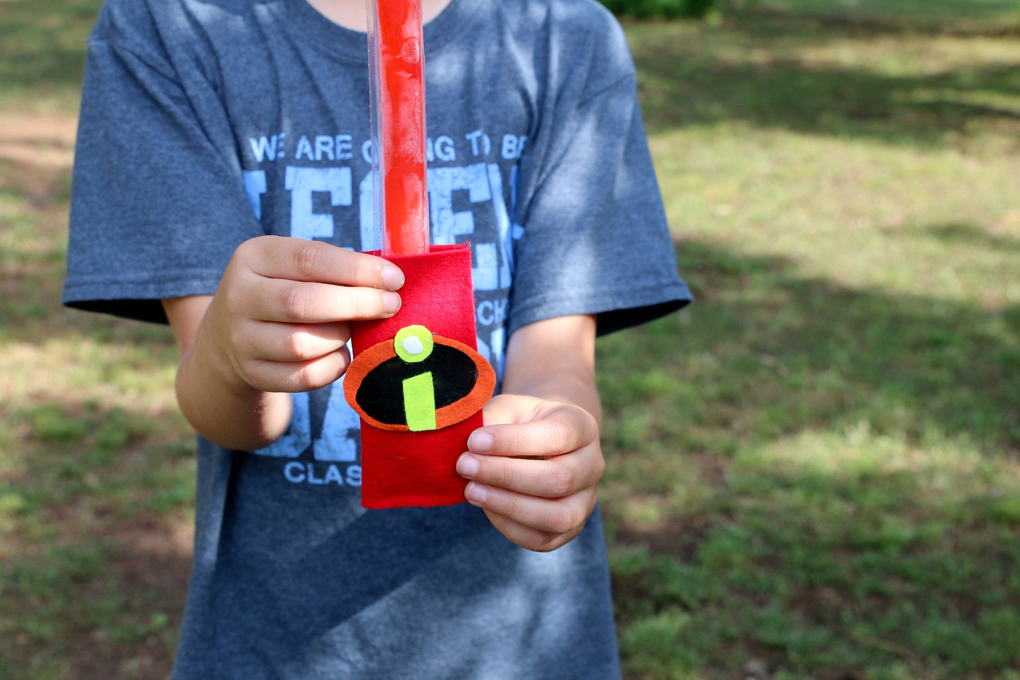 Noah holding his Incredibles popsicle