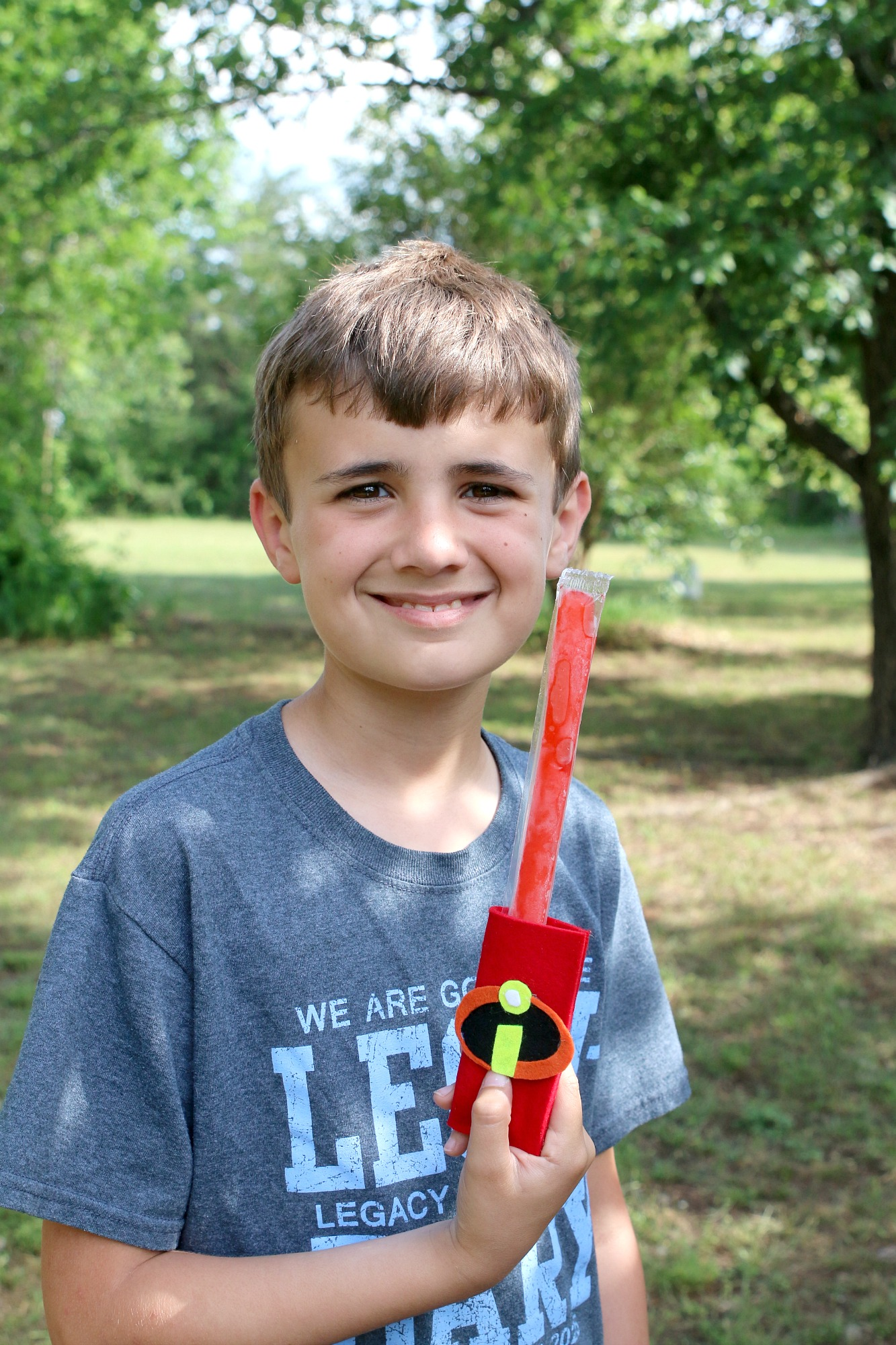 Noah with DIY Incredibles Popsicle Holder