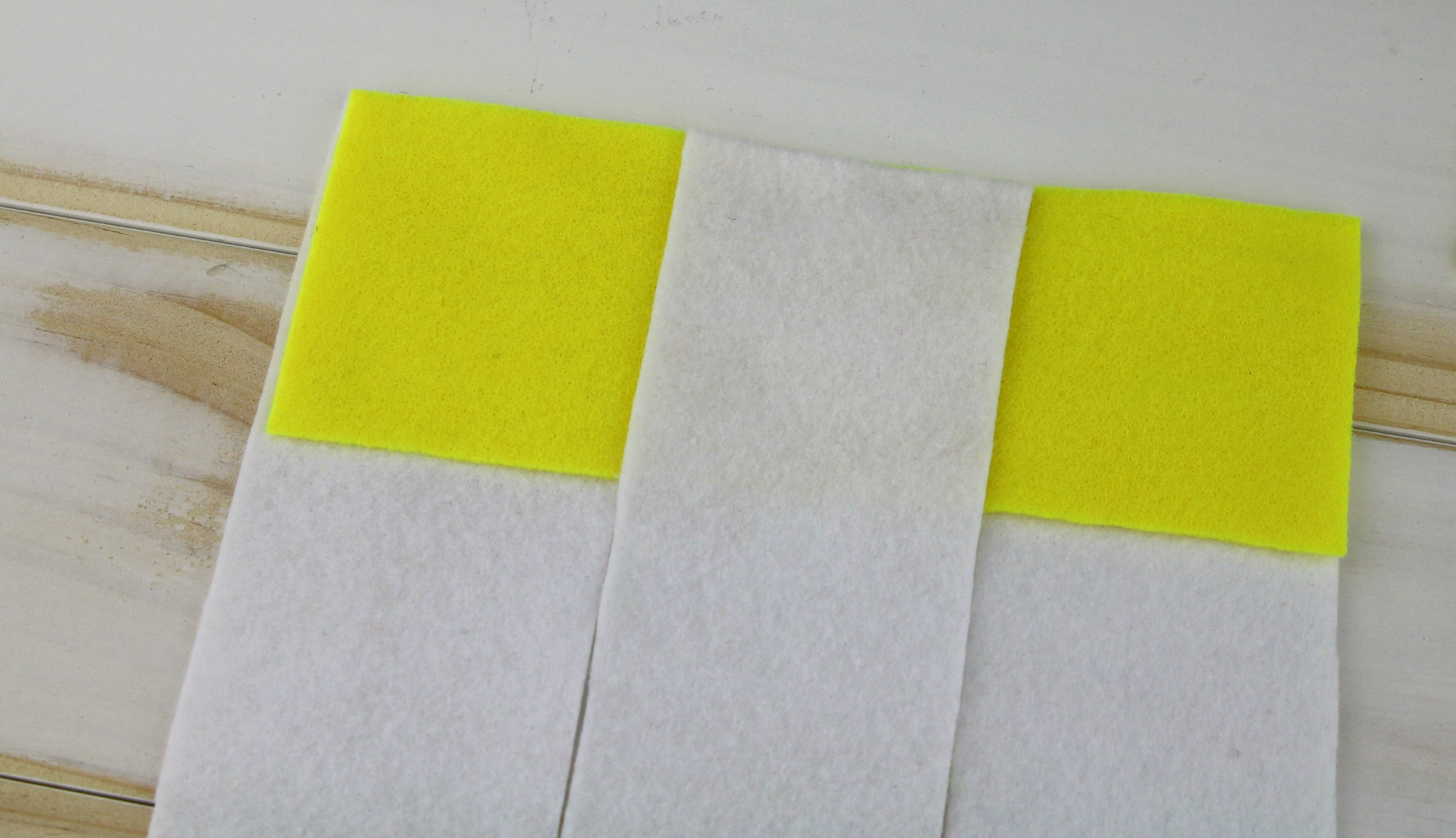 place yellow felt for checker board