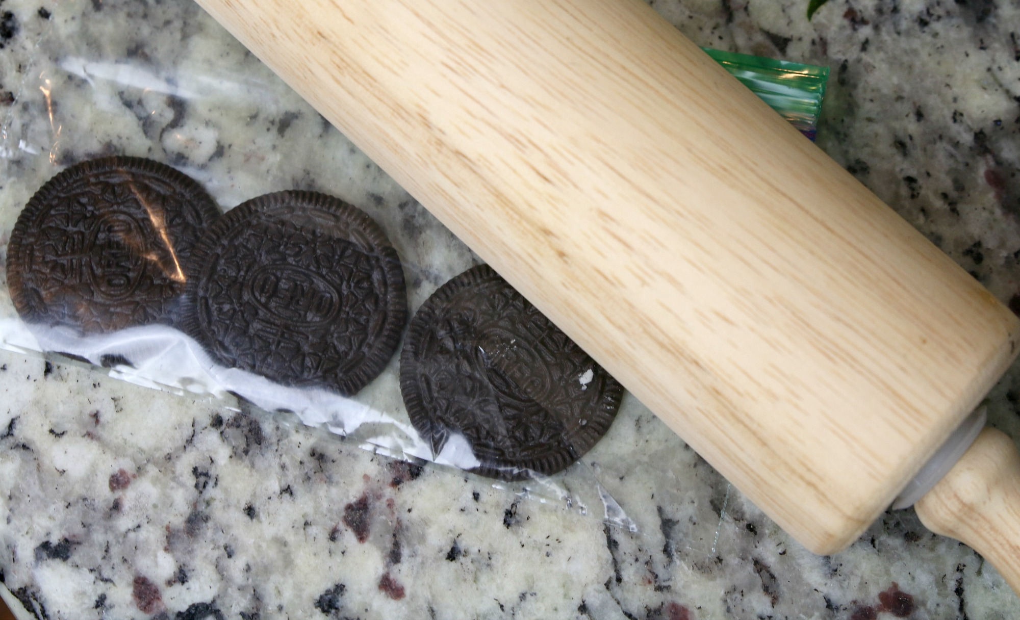 crush Oreo cookies with rolling pin