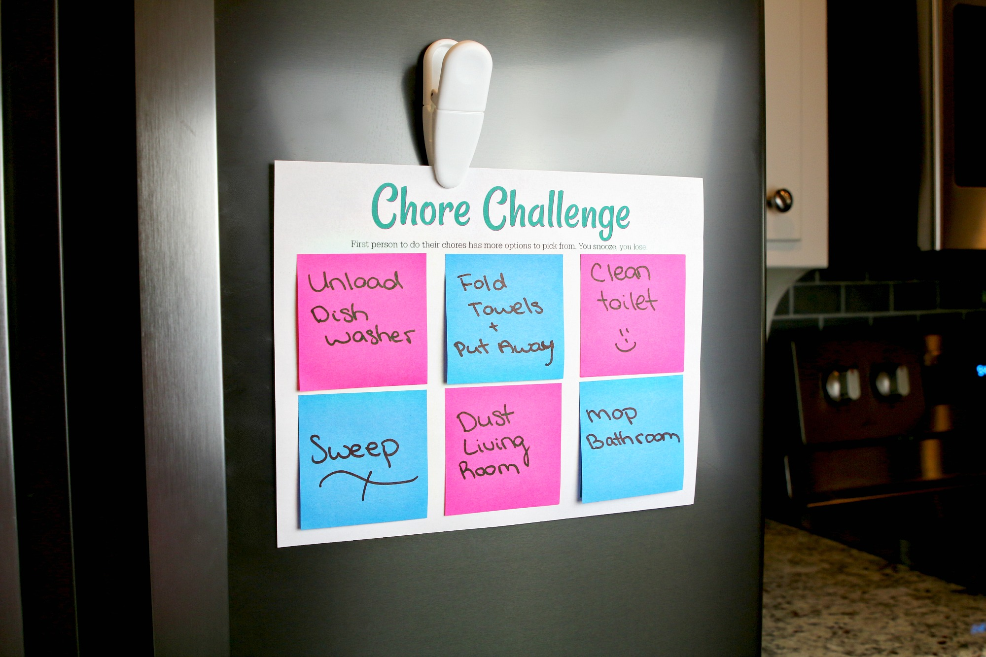 hang chore challenge chart on fridge