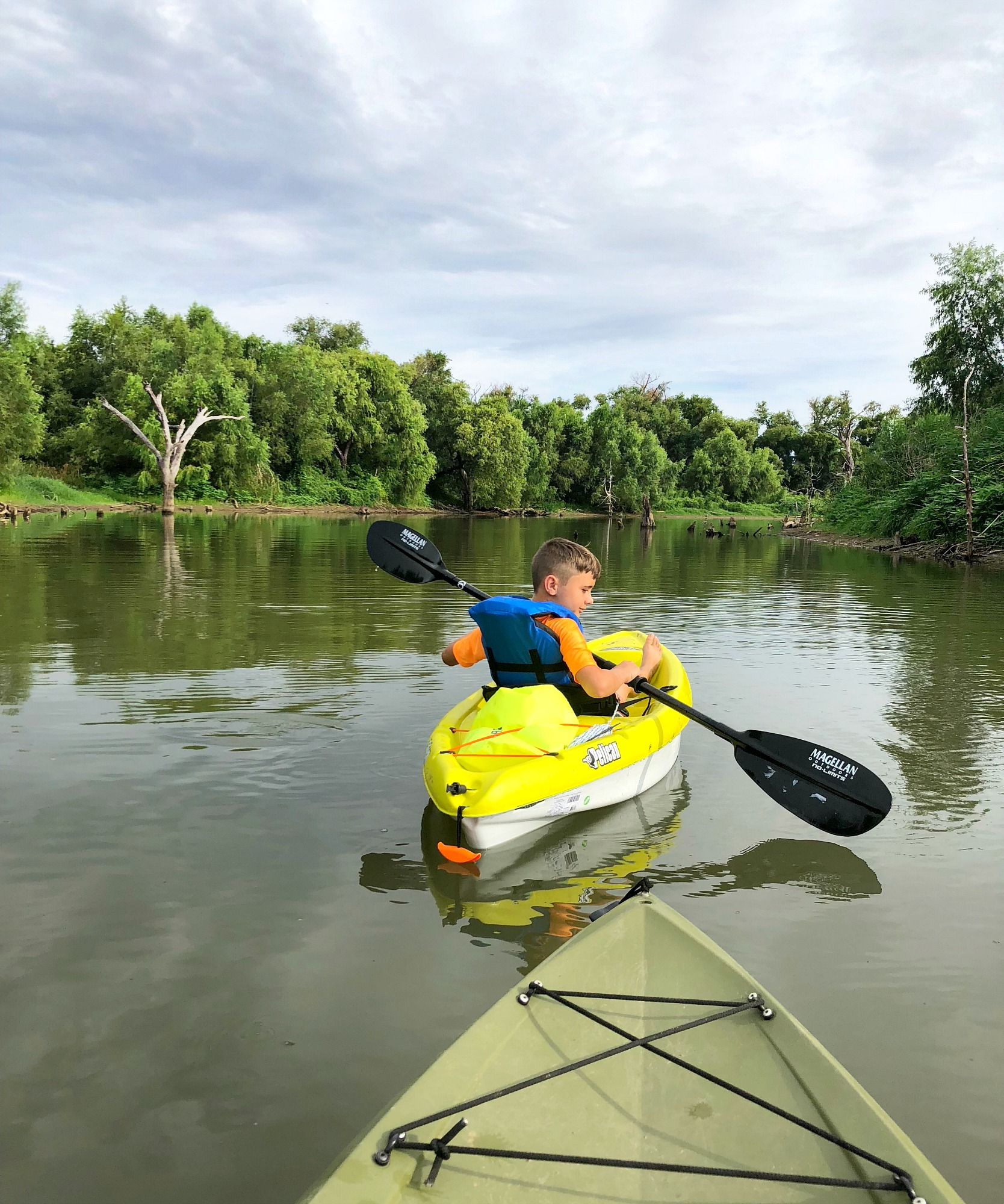 Noah kayaking the river