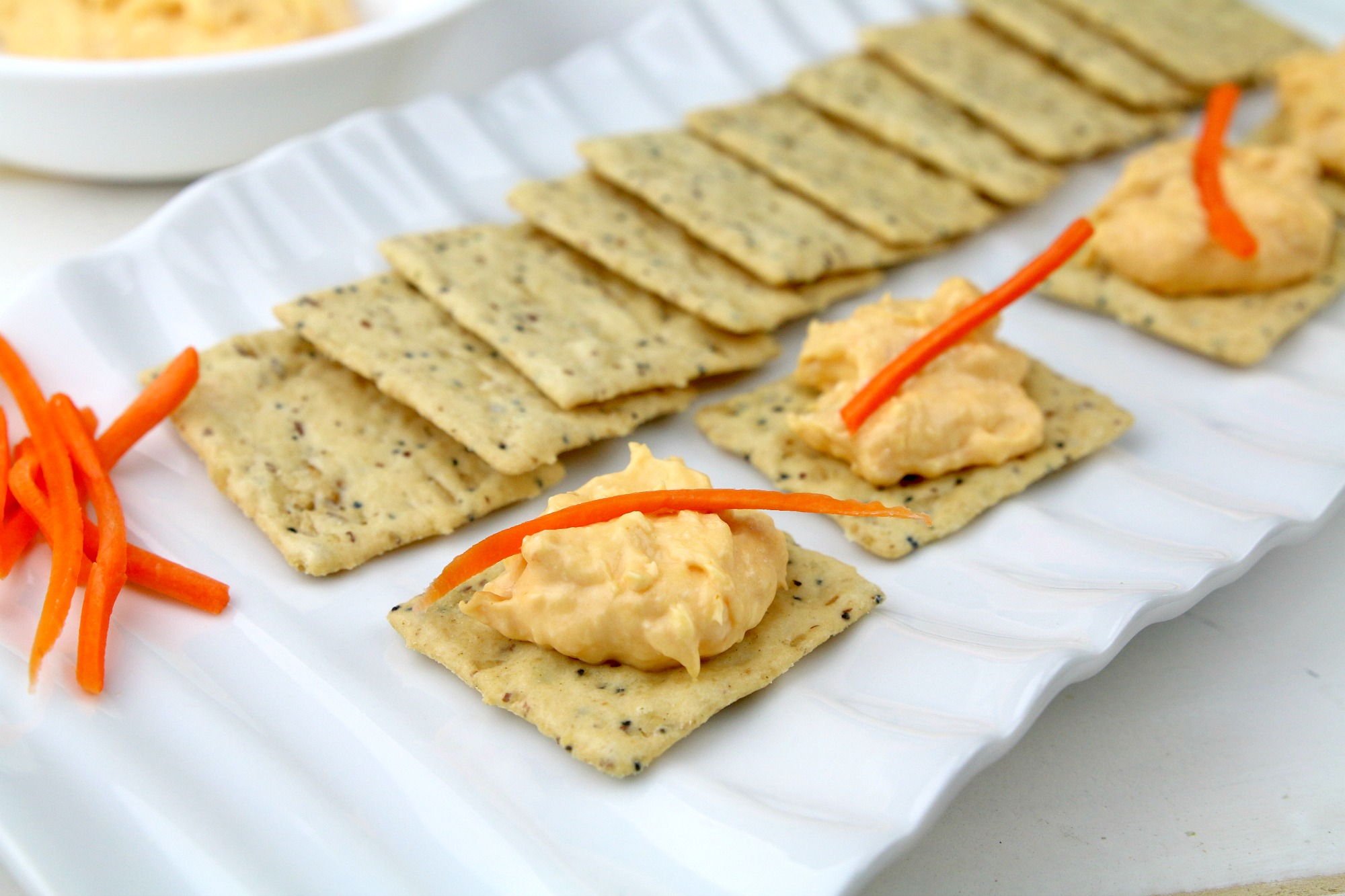 Honey Buffalo Chicken dip to crackers