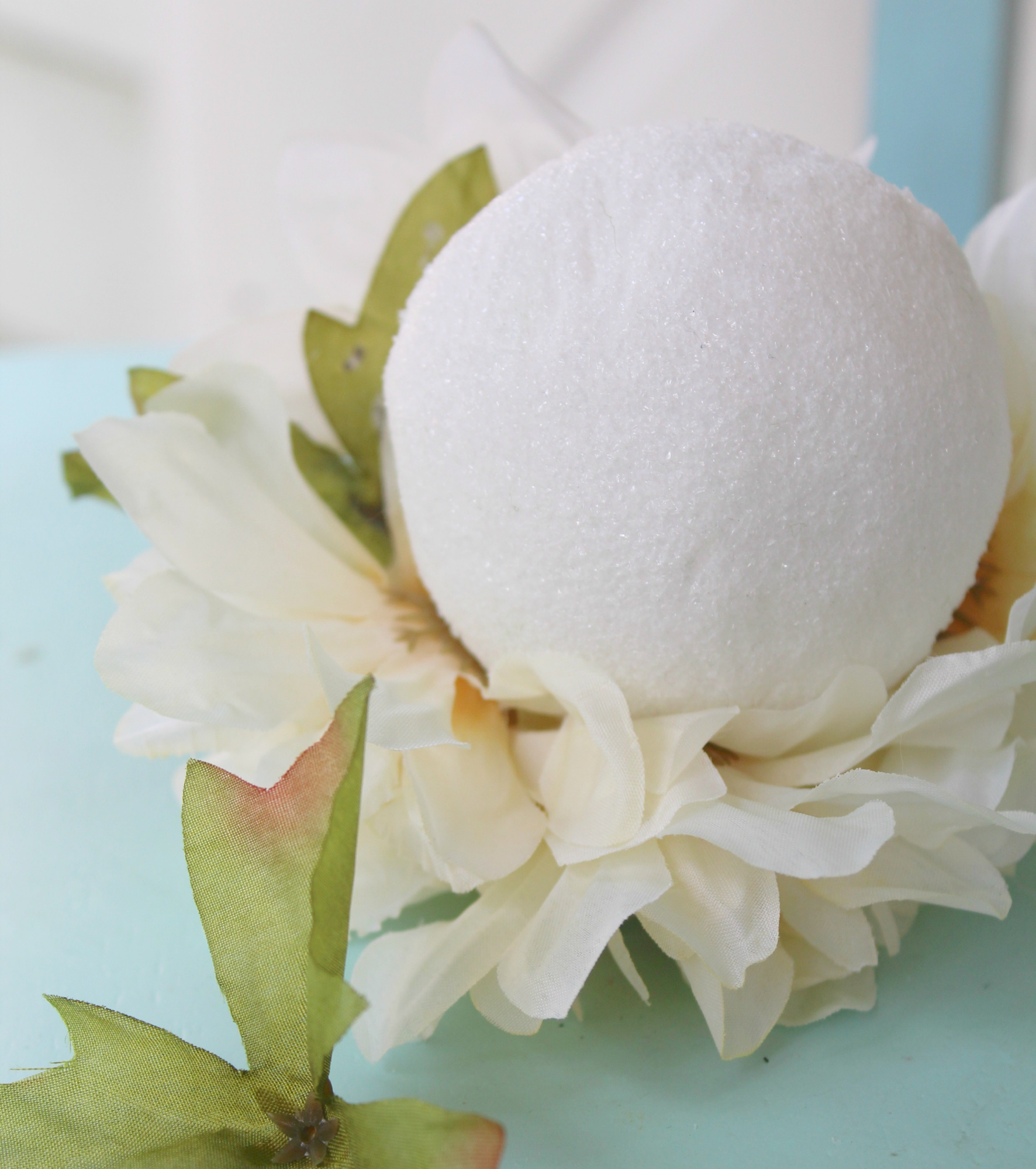 add faux flowers to foam ball