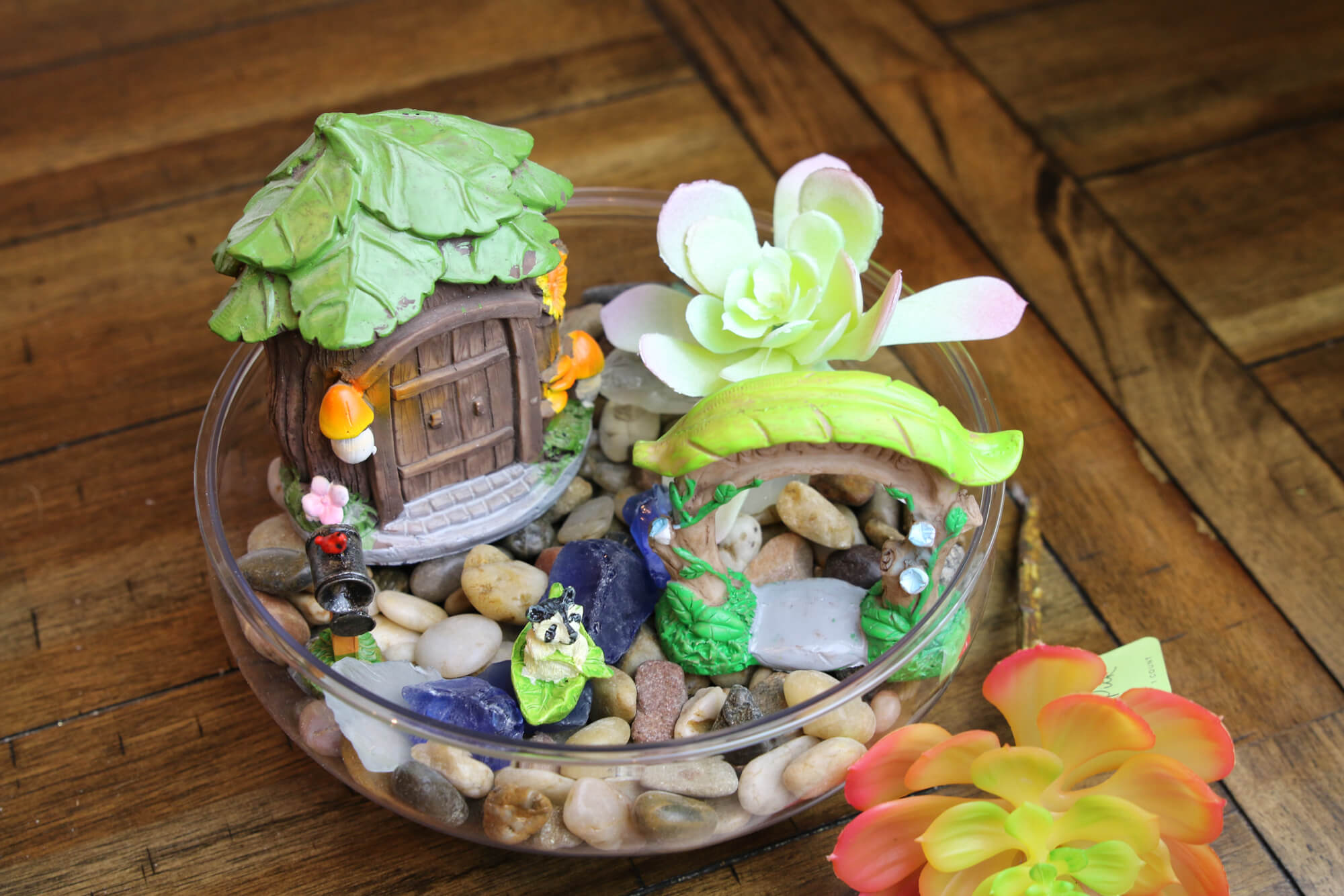 add faux succulents to fairy garden for kids