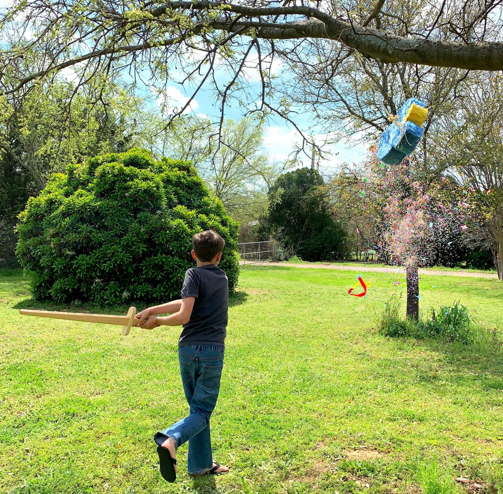 Noah hitting piñata