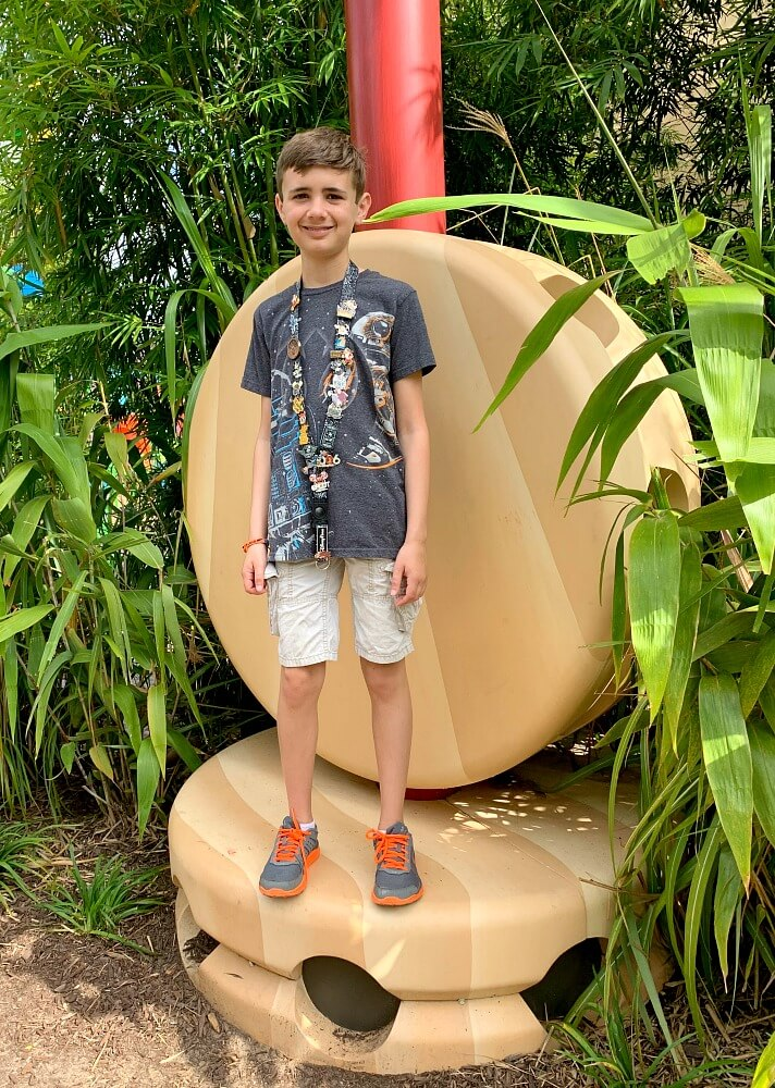 Noah standing on tinker toys in Toy Story Land