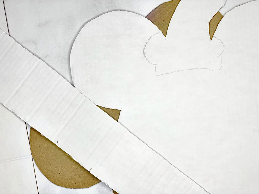 cut dumbo piñata pieces from cardboard
