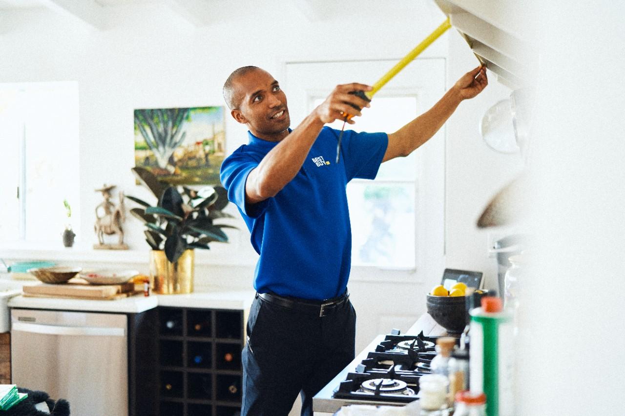 Best Buy employee helping inside home